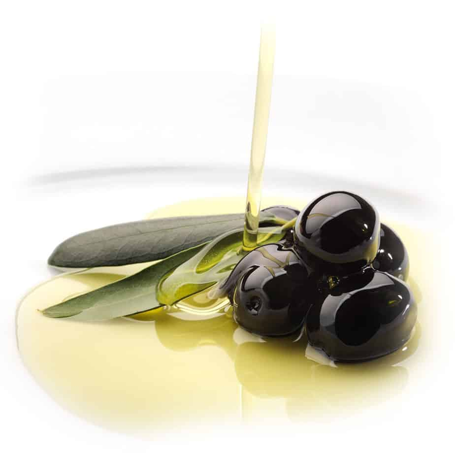 high phenolic olive oil being poured on black olives