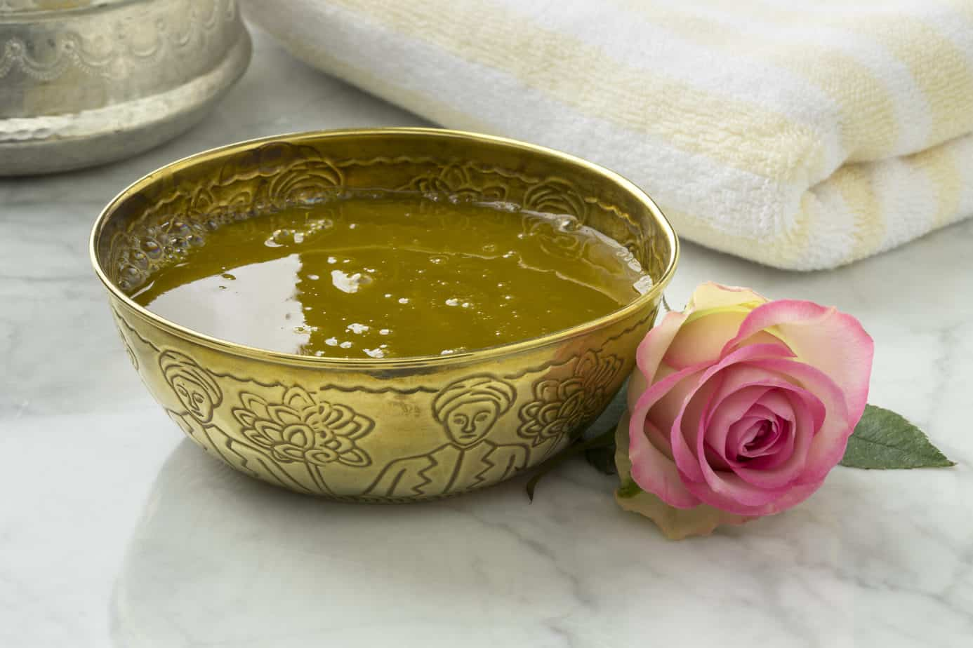 Olive oil with rose extract for skin care.